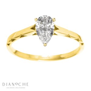 One diamond ring pear shaped yellow gold