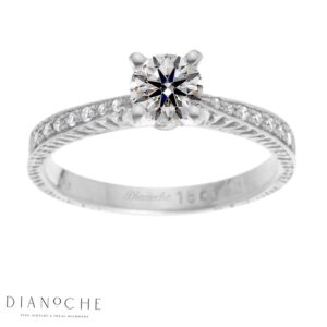 Round diamond ring with side stones white gold