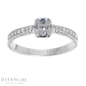 Cushion cut diamond ring with side stones white gold