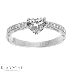 Heart diamond ring with side stones white gold