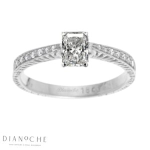 Radiant diamond ring with side stones white gold