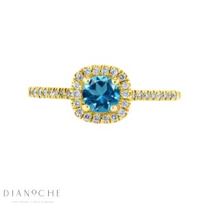 Blue topaz diamond ring yellow gold