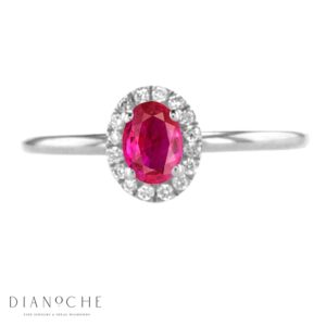 Oval ruby ring with diamonds white gold